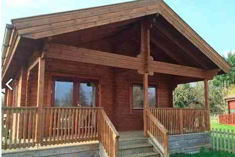 Watermeadow Lodges - Overnight luxury lodge stay for up to four people with a hot tub, a bottle of Prosecco to share, a breakfast hamper and late check out - Save 34%