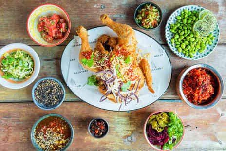 Backyard Chicken - Whole fried chicken and two sides for two people with a glass of bubbly each - Save 51%