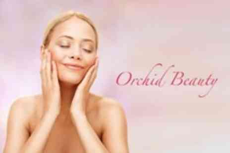 Orchid Beauty - Microdermabrasion Facial and Grapefruit Back Therapy Plus Eyebrow Wax and Tint - Save 54%