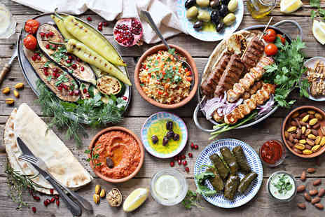 Mezopoly - Greek dining for two people including six sharing meze dishes and a main dish each or a bottle of wine - Save 56%
