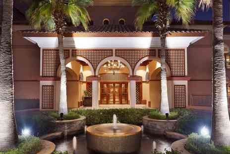 value added travel - Luxury Ritz Carlton Dubai escape with flights and meals - Save 0%