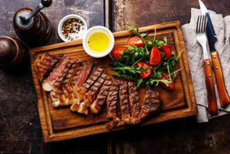 Revival Cafe Bar And Grill - Steak Meal with Glass of Wine for Two or Four - Save 48%