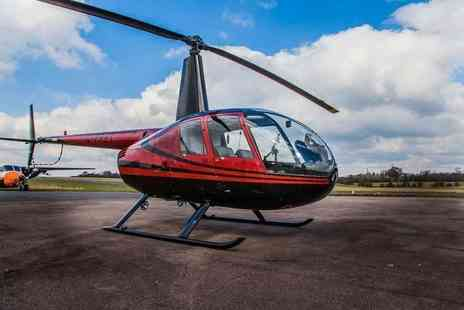 Flying Pig Helicopters - Romantic helicopter flying experience for two with a glass of bubbly each and chocolates - Save 30%
