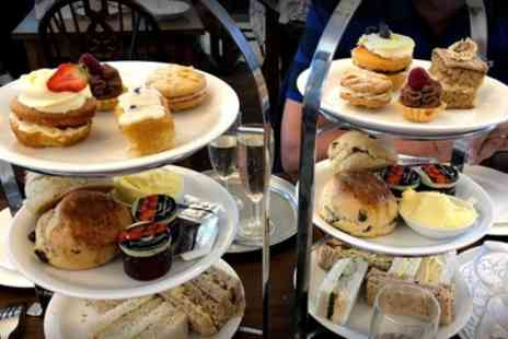 The Village Tearoom - Afternoon Tea with Optional Prosecco for Two or Four - Save 40%