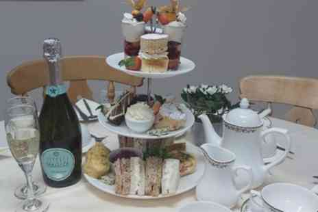 Booths Tearoom at Tweedmill Shopping Outlet - Traditional or Sparkling Afternoon Tea for 2 or 4 - Save 35%
