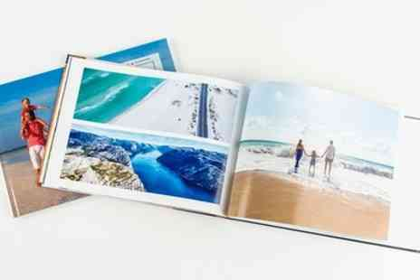 Colorland - Up to Five Personalised Hardcover A4 Photobooks with Up to 60 Pages - Save 92%