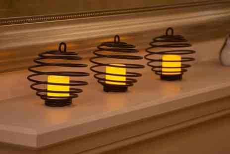 Groupon Goods Global GmbH - Set of Three or Six Spiral Flickering LED Candles - Save 0%