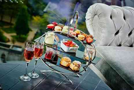 Black and White Hospitality - Traditional afternoon tea for two people - Save 30%
