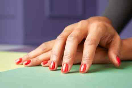 Uptown Beauty - Shellac Manicure or Pedicure or Both - Save 46%