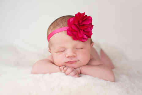Jigsaw Photography - Newborn baby photoshoot including an A4 canvas - Save 0%