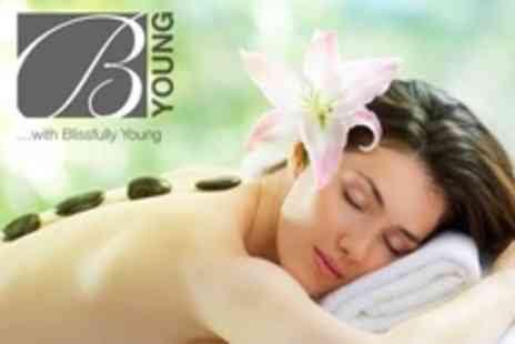 Blissfully Young - Hot Stone Massage With Deluxe Manicure or Pedicure For One - Save 60%