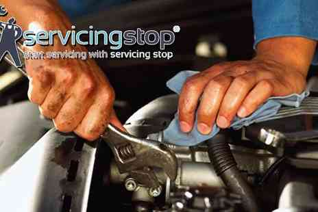 Servicing Stop - Get your car all set for long drives in the summer with an MOT check - Save 53%