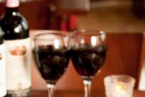 El Toro Restaurant - Two Steaks, Two Sides, and Two Glasses of Wine - Save 55%