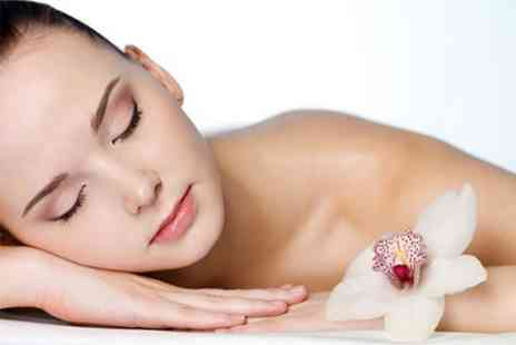 The Spa Boutique - Microdermabrasion Facial and Hot Lava Shells Massage - Save 73%