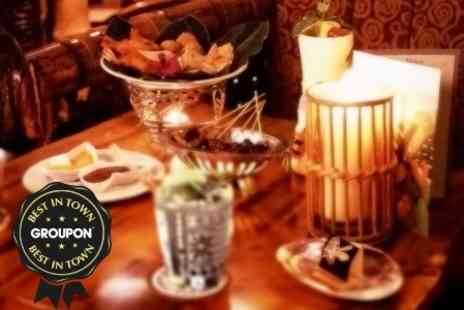 Trader Vics - Three Courses and Bottle of Wine For Two - Save 43%