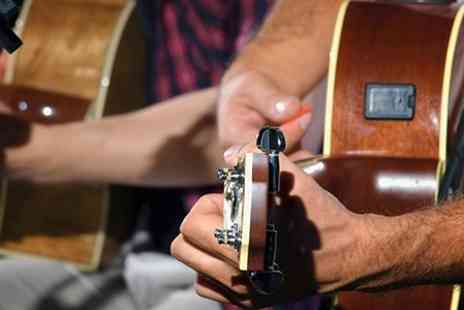 Guitar Cities - Two, Four or Six Private Lessons - Save 56%