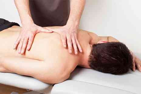 Shield Clinic - Chiropractic Consultation Exam and Two Treatments - Save 86%