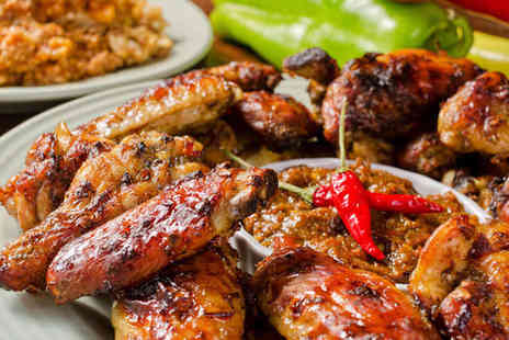 Taes Tavern - All You Can Eat African and Caribbean Buffet for Two People - Save 50%