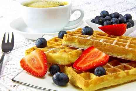 The Stuart Hotel - Hot waffle with choice of topping such as strawberries and cream - Save 46%