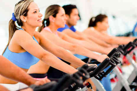 Muscle Mania Fitness - One Month  Membership in Main or Womens-Only Gym Ten Fitness Classes - Save 51%