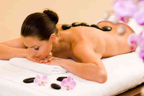 Healing Touch Academy - Hot stone back massage include a cold stone facial - Save 52%