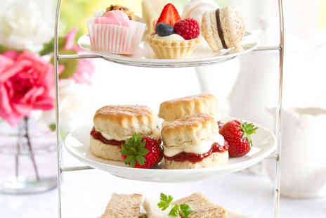 The Angel Hotel - Afternoon Tea for Two  with a Glass of Sparkling Wine Each - Save 51%