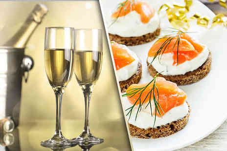 The Hilton Hotel - Bottle of Prosecco and canapes for 2 - Save 65%