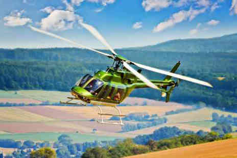 Whizzard Helicopters - 10 mile helicopter buzz flight over Aintree, Manchester or Welshpool  - Save 49%
