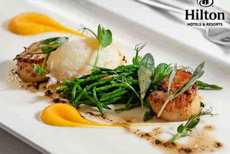 Hilton London Green Park - Three Course Meal with Champagne Cocktail Each for Two   - Save 43%