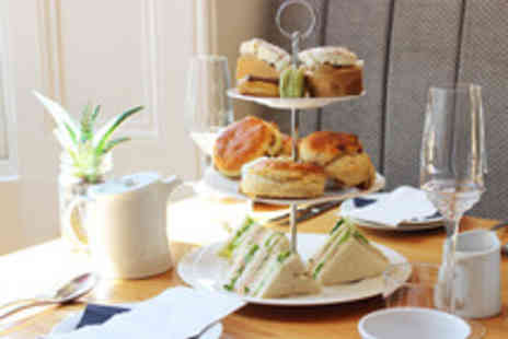 Rydges Hotel - Afternoon Tea with Optional Prosecco for One - Save 52%