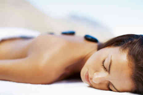 Beyond Beauty - Hot Stone Back, Neck, and Shoulder Massage - Save 50%