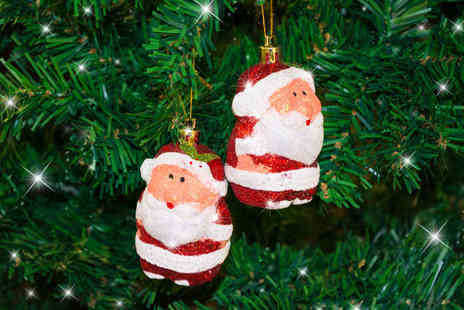 CK Collection - Four Santa baubles for six - Save 67%