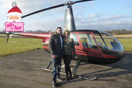 Flying Pig Helicopters - Romantic helicopter flying experience for two including bubbly and chocolates - Save 50%