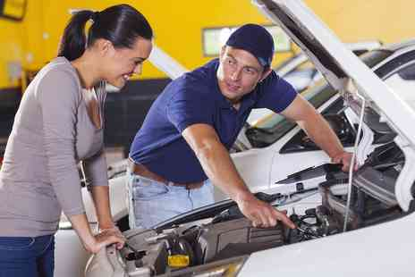 Bennett Motor Works - 54 Point Car Service, Oil and Filter Change, Pick Up and Drop Off  - Save 0%