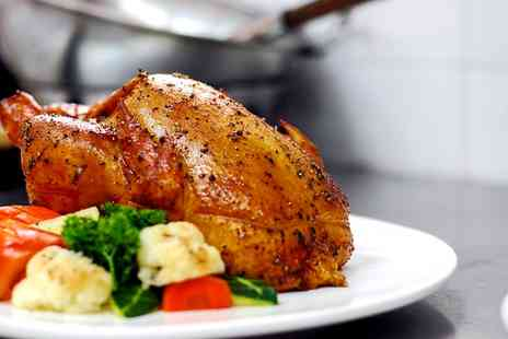 The Manor Hotel - Two Course Sunday Roast with Trimmings and Bubbly for Two or Four  - Save 0%