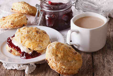Patisserie Valerie - Scones with jam and cream plus a pot of tea for two - Save 46%