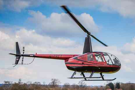 Flying Pig Helicopters - Helicopter Flying Lesson For One, Two or Four- Save 56%
