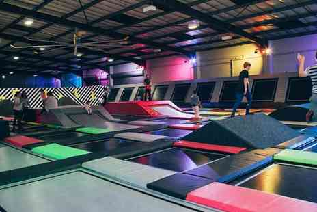 Jump Inc - Entry to Trampoline Park Grand Opening Plus Socks for Up to Four - Save 32%