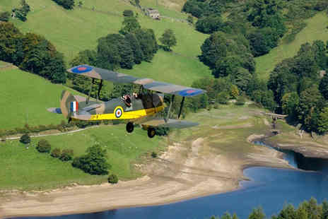Blue Eye Aviation - WW2 aircraft flight experience for one person with bubbly, uniform hire and a framed photograph - Save 54%