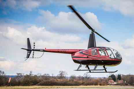 Flying Pig Helicopters - Helicopter Flying Lesson for One or Two or a Private Lesson for Three - Save 56%
