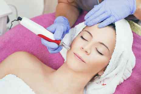 Vega Clinic - Five Microdermabrasion Facial Sessions - Save 0%