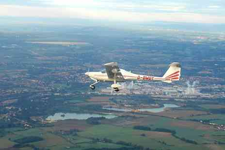 Starsfly Flying School - 30 or 60 Minute Flying Lesson on a Two or Four Seater Plane - Save 36%