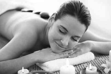 Beauty on the Spot - 30 minute hot stone massage and a 30 minute facial for one - Save 67%