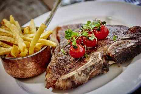 Marco Pierre White - Sirloin steak meal for two with chips, salad, side dish and a glass of wine each - Save 61%