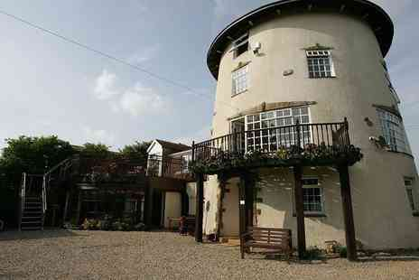 The Old Mill - One or two night Yorkshire windmill stay for two with wine - Save 28%