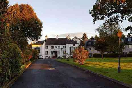 Gretna Hall Hotel - Overnight stay with £20pp dining credit, breakfast, late check out and tickets to the Gretna Green Story Telling exhibition - Save 53%