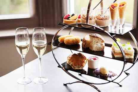 Reynolds Group - Afternoon Tea, Bubbly & All Day Spa Access - Save 45%