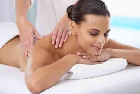 The Sanctuary - Full Body Hot Stone or Aromatherapy Massage with Optional Facial - Save 63%
