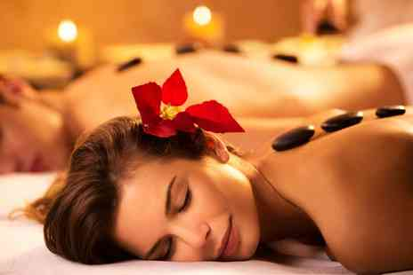 Jadore Beauty and More - 30 or 60 Minute Hot Stone Couples Massage - Save 53%
