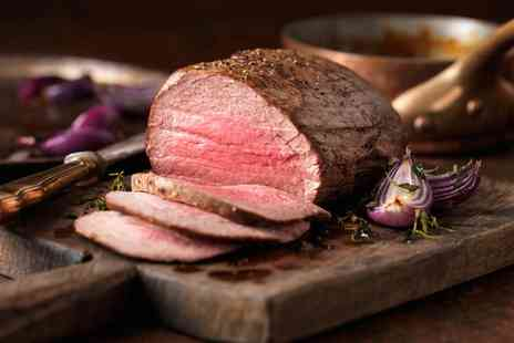 Charlies Bistro - Sunday Carvery Roast with Glass of Wine for Two or Four - Save 32%